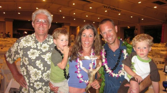 Jamie pictured with her father, sons Ryder and Christiand and husband Courtney in Maui where she was recently inducted in the Xterra Hall of Fame